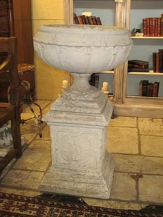 Wonderful detailed pair of concrete urns on plinths