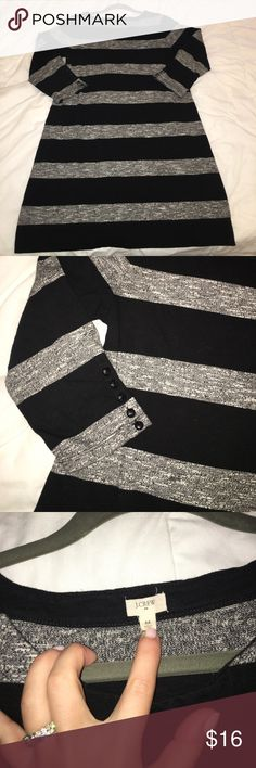 "J Crew grey and black sweatshirt dress Jcrew Factory size medium black and grey sweatshirt material dress. Size medium. Has a boxy fit and 3/4 length sleeves with black buttons. One sleeve has 3 small holes that came on it when purchased that are hardly noticeable and appear to be from buttons (last photo) 33.5"" from shoulder to hem. J. Crew Dresses Midi"