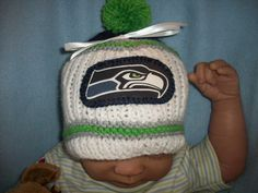 Custon Handmade NFL SEATTLE SEAHAWKS Baby Hat/ Beanie in Team Colors. $25.99, via Etsy.  I like the emblem on the front, I need to find two for my kid's beanies that I will crochet for them!