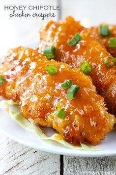 Easy oven fried chicken tenders tossed in a sweet and spicy honey chipotle sauce!