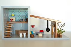 Wooden dollhouse fully furnished by Macarena Bilbao #woodentoy #woodendollshouse #macarenabilbao