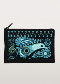 Who can sparrow a moment digging around a big bag for loose change? This stylized Peruvian bird with geometric patterning in black and teal keeps coins in one place. A hand-embroidered coin purse from artisans of Intercrafts Peru.