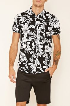 In a leafy floral print woven, this slim fit shirt features a basic collar, a button-up front, a chest patch pocket, and short sleeves.