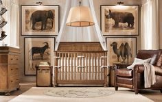 The most fabulous decor for a boy nursery.  Adore the oversized animal prints and the worn leather chair.