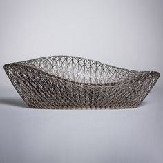 Janne Kyttanen builds 3D-printed sofa from a minimal mesh The 3-D printing pioneer used structures of spiderwebs & silkworm cocoons to inform the design of a sofa he printed in a single piece. The prototype sofa created on 3D Systems' ProX 950 SLA device, a stereolithography machine that builds up the shape from a photo-reactive resin by curing it with a UV laser. 6,000 layers each 0.0099 cms thick make up the sofa of 2.5kg, minimising energy usage & transport costs in furniture production.