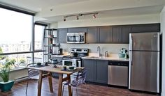 Are you trying to find ideas about one wall kitchen design? If so, here is our list of the best one wall kitchen layouts for you. Dark Grey Kitchen Cabinets, Gray And White Kitchen, Grey Kitchens, Home Kitchens, Gray Cabinets, Metal Cabinets, Kitchen Grey, Kitchen Cupboards, Charcoal Kitchen