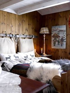 I love how they have used the ski to tie the pillows to to make a Nordic headboard! cabin log rustic house in Norway Cabin Homes, Log Homes, Norwegian House, Chalet Design, Wooden Cabins, Cottage Interiors, Lodge Decor, Home Bedroom, Bedrooms