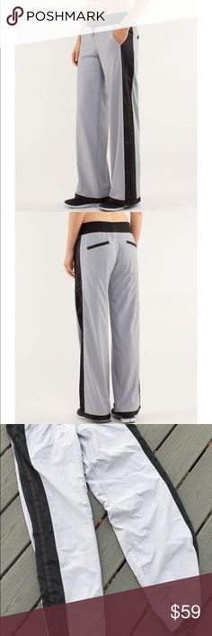 Lululemon Run Right round track wind pants size 4 Lululemon Run Right round track wind pants  COOLMAX® liner is moisture wicking to pull sweat away from your skin Glyde fabric is wind and water resistant to help protect you from wet weather cinch the continuous drawcord at the hem to help prevent wet ankles the smooth elastic waistband fabric(s): Glyde with DWR finish (Durable Water Repellent), COOLMAX® properties: wind and water resistant, moisture-wicking, two-way stretch rise: medium leg…