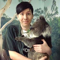 PHIL WITH A KOALA LOOK AT HOW TRULY HAPPY THIS BOY IS