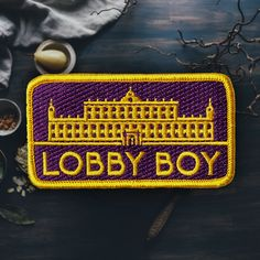 I wanted to design a patch around the Grand Budapest Hotel for Mr. Lobby Boy. The patch is meant to look like a badge the Lobby Boy would wear to show his position at the hotel. Let me know what you t