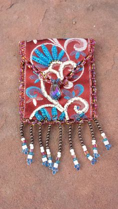 Check out this item in my Etsy shop https://www.etsy.com/listing/263305028/beaded-gift-bag-native-american-inspired