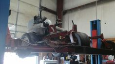 Mower on the lift getting a look at! Servicing your machine yearly is always a great idea! Helps prevent your machine from future damage! #stallingsnc #monroenc #charlottenc #charlotte #monroe #stallings #local #unioncountychamber #indiantrailnc #mower #lift #moweronlift #service #servicing