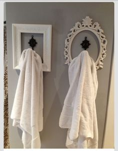 Find an awesome frame, use a great hook or window curtain hook to hang. Fun and easy!