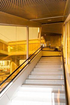 Colourful stairwells zigzag up to meet Metro Arkitekter's Skyttlebron railway bridge