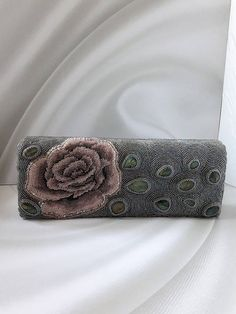 Beautiful evening gray bead embroidered clutch with labradorite cabochons. Its believed that labradorite is mystic a stone that give you energy and helps to become the person that you are destined to be. Measurements -3 1/2 inches tall -10 inches long  - 1 1/2 depth  Long chain is