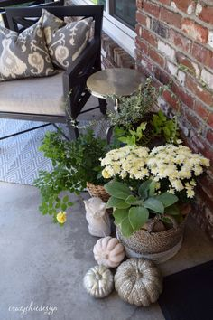 Create a lovely Autumn vignette in cool neutral tones on your front porch.  Baskets are perfect for housing your Fall flowers and plants.  Sparkly pumpkins, a garden owl and cozy pillows complete the look.   HomeGoods Sponsored Pin.