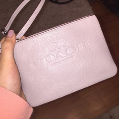 Coach Clutch Small Coach New York Clutch. New without tags, no stains or damage. Color is light tan/beige. Coach Bags Clutches & Wristlets