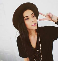 The beautiful Ally Hills throwing up a peace sign.
