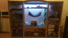 DIY Ferret Cage. Made from old TV entertainment center. Thanks to my bf.