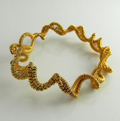 Twist and Turn 6 5/8ths Inch woven copper and gold artistic wire bangle style bracelet £23.64 GBP