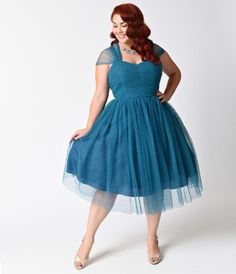 Perfect for your next garden party or afternoon tea, this plus size vintage teal swiss dotted dress will give you a feminine look thats straight out of the 1950s. The A-line shape is a flattering silhouette, as its cinched waist slims your midsection and