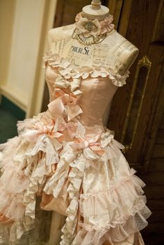 Pink and vintage...what could be better??? Love this gorgeous peach corset dress on this dress form