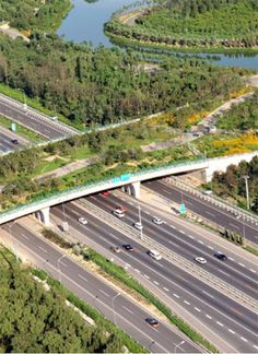 Beijing Olympic Forest Park overpass. The park project was a team effort led by Hu Jie, ASLA, that included some 200-300 experts from many disciplines. A new mountain was built out of the reclaimed debris from the new Beijing subway and Olympic stadium construction projects. The new lake was filled with reclaimed water. The lake water, which is residential grey water, as well runoff, rain, and flood water, is cleansed through a man-made wetland, where it's then used to maintain the…