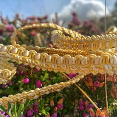 Troynorth Culbin and Antique Braid, is  a 1cm decorative braid, a classic design using yarns in rich golds, creams and royal primary colours.  This ornate braid is ideal for upholstery and soft furnishings.