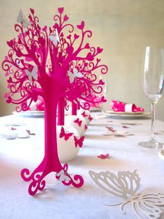 Hot pink paper table decorations for a girl's birthday party or wedding