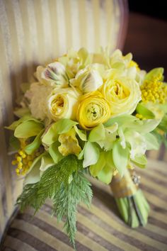 Soft Green and Yellow ranunculus, tulips and cymbidium orchids