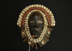 "African Chokwe style mask with Cowrie shells sewn throughout approx 15""T. African Art Auction ending 5/29/13"