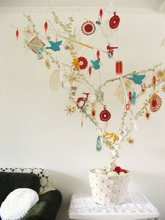 a 'whatnot' gleeful tree... ~ dottie angel this is so simple, yet so beautiful. makes me want to add more to the kids' tree in their room.
