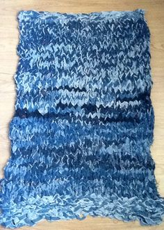 Handmade rug knitted from old jeans ripped into long strips that were sewn together. Good project for long winter nights. And it's a great arm workout!