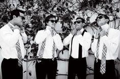 Groomsmen wearing plaid ties at a San Ysidro Ranch wedding