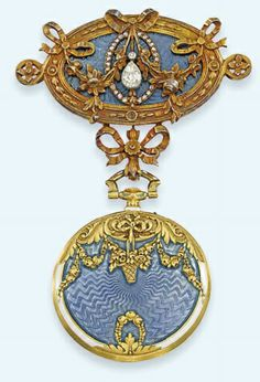 AN EARLY 20TH CENTURY DIAMOND AND ENAMEL FOB WATCH AND BROOCH, ca. 1905