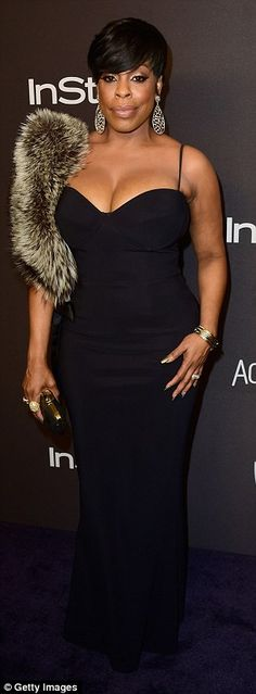 Showing off: Kat Graham (left) and Niecy Nash both displayed plenty of cleavage...