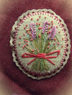 linen brooch with embroidery