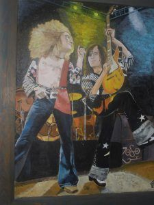 Page and Plant -  Jimmy Page and Robert Plant is on a 48″ x 36″ wood board all routered out to different levels.  Works done by Bruce J Schmalfuss