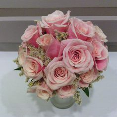 Bridal bouquet of beautiful two-tone pink roses with antique white german statice collar