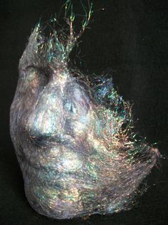 Angel Face 2013 Angelina fibres 18x15x10cm The discovery of Angelina fibres has resulted in a self portrait in textiles. The fibres were heat moulded onto a plaster cast of my face. Please see more of my work at https://www.etsy.com/uk/shop/Fibreandstitch?ref=hdr_shop_menu