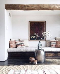 Bohemian bench for nook of living room with mixed prints and natural design details