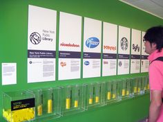 Walker graphic design exhibit activity: vote for old or new logos for the New York Public Library, the YMCA and Pfizer