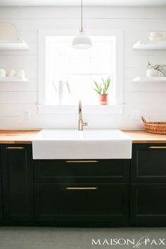 Love modern farmhouse style? This DIY modern farmhouse kitchen will blow you away: shiplap, open shelving, color blocking, butcher block counters... all affordable and super stylish!