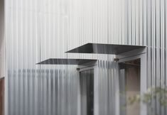 metallic palette: stainless steel awning, corrugated metal cladding