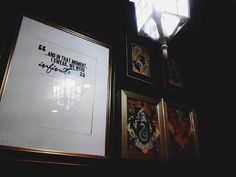 """Pin for Later: Say """"Espresso Patronum"""" (or Butterbeer!) at This Magical Harry Potter Cafe Hogwarts house art adorns the walls."""