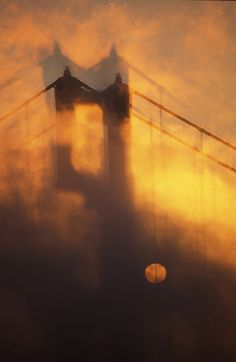 A rare moment to see the sun rise in the fog at the golden gate bridge in San Francisco.