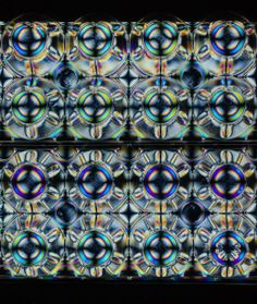 Anisotropy frozen in a plastic egg tray during the process of molding creates symmetric stress birefringence that is revealed as chromatic r...
