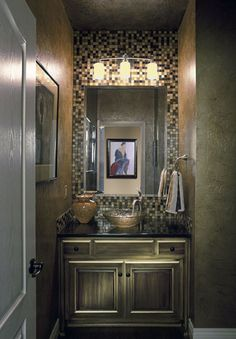 perfect guest bathroom! Love the tile work, textured walls, black countertop, and bowl sink!