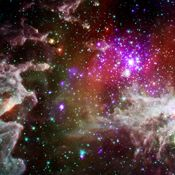 This composite image of the star cluster NGC 28 contains X-ray data from Chandra, in purple, with infrared observations from Spitzer, in red, green, blue. NGC 281 is known informally as the 'Pacman Nebula' because of its appearance in optical images.