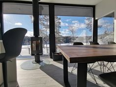 This Villa aims to capture the essence of minimalistic structure, transparency and reflection of light combined with contemporary Scandinavian wood design. Glass House Design, Small Lake, Scandinavian Interior Design, Light Reflection, Winter Scenes, Wood Design, Villa, Dining Table, Minimalist